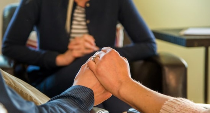 couple holding hands in therapy